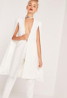For a luxe look that doesn't break the bank, look to this crisp white cape for style inspo. In a blazer style, wear with white cigarette trousers and heels for a polished look.