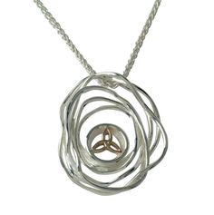 Celtic Necklace- Celtic Cradle of Life PPX10479 Sterling Silver & 10Kt. Celtic Cradle of Life Necklace. Sterling Silver and 10Kt Yellow Gold. Center Celtic Knot is Solid 10Kt Gold. Spiga Chain is Sterling Silver and 18 inches Length. Designer Keith Jack.