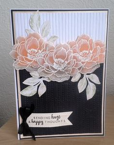 "By Maria Illsley. Flower stamp from ""Beautiful Day"" by Altenew. Stamp 3 flower outline images onto vellum; heat emboss with white powder. Color on the back side with peach and orange inks. Hand cut each flower."