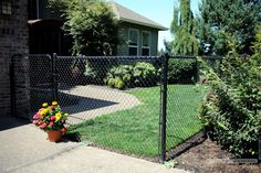 New Blog Post - Enhancements in Chain Link Fencing Offer Attractive Fence Designs for Your Home. Vinyl-coated or not, a chain link fence can also be used in creative ways to set your home or yard apart from the rest of the neighborhood. #fence #fencing #outdoorliving #blogpost #chainlink
