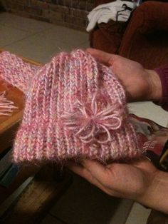 Pink Knifty Knitter hat with flower