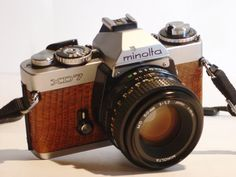 Custom Minolta XD-7 35mm SLR 1977 camera with full equipment.