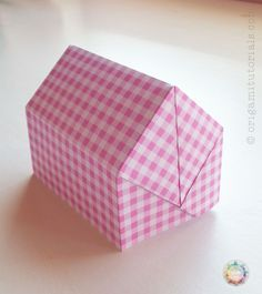 Introduction to a cute one-sheet Origami house with CP and picture guide , which can also be used as an Origami lamp when a LED tea light is placed inside.