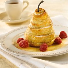 Wrapped Pears with Vanilla Bean Sauce - Impressive and delicious, this is the perfect recipe to make your guests feel special. The puff pastry, pears and vanilla cream sauce complement each other to give layers of flavor to this mouthwatering dessert.
