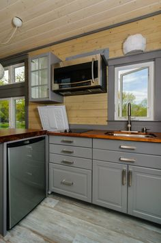 A 30′ tiny house on wheels with front dutch door in Asheville, North Carolina. Built by Wishbone Tiny Homes.