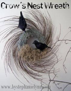 I love the air-y feeling of this wreath.  I might exchange the birds for something more friendly after Halloween.