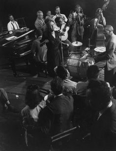 "When LIFE featured jazz giants Duke Ellington, Count Basie and Billie Holiday in 1943, the magazine described Holiday as having ""the most distinctive style of any popular vocalist."" If only we had a video of this jam session. See more: http://ti.me/169dh0a (Gjon Mili—The LIFE Picture Collection/Getty Images)"