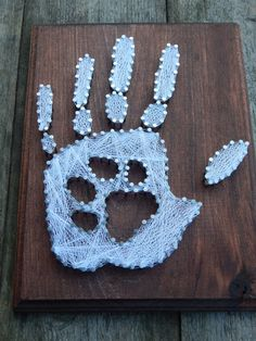 Hand print with paw print string art by MakeupAndMudCrafts on Etsy https://www.etsy.com/listing/238276375/hand-print-with-paw-print-string-art
