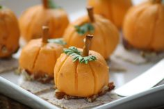 Mini Pumpkin Cheese Balls - Soft processed cheddar cheese rolled into balls. Use toothpick to score, and pretzel sticks and parsley to decorate.