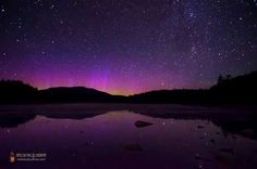 The northern lights envelop Maine's highest mountain in purple and magenta and reflect off a nearby pond in this beautiful night sky photo. Mike Taylor captured this image about six miles south of Mt. Katahdin on July 13, 2013. How did he do it? http://oak.ctx.ly/r/1znh1