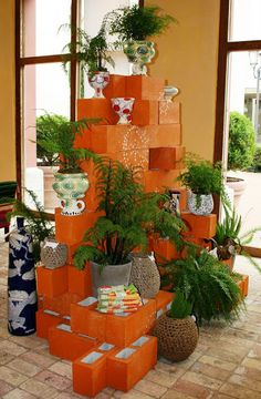 Concrete blocks painted orange with enough green plants and grey and white pots to tone 'em down. ciao! newport beach: ANTHROPOLOGIE ~ fashion island