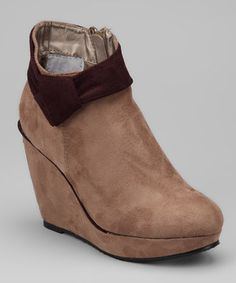 Make a surefire style statement with these one-of-a-kind wedge booties. With a sleek two-tone design and an ultra-soft upper, this pair promises to finish any ensemble with fashion-forward flair.