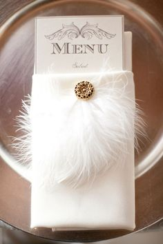 Gatsby style and inspired weddings are always the first that come into our minds when we talk about feathers in weddings. However, as today 's new fashion goes , more chic and modernized feather elements are ad. Gatsby Theme, Great Gatsby Wedding, Vintage Wedding Theme, Art Deco Wedding, Mod Wedding, Wedding Menu, Hotel Wedding, Trendy Wedding, Wedding Table