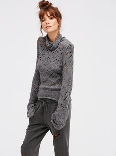 Shoot From The Heart | Turtleneck sweater with cute cutout details throughout…