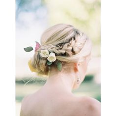 """A #sidebraid, #bridalbun and #floral accessories is one seriously pretty #summer #bridal look! #bridalbeauty #weddinghair #hairinspiration 