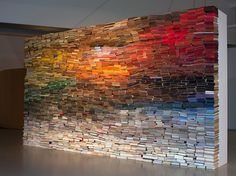 This wall by artist Anouk Kruithof, entitled Enclosed Content Chatting Away in the Colour Invisibility, consists of more than 3,500 colorful bound books, s