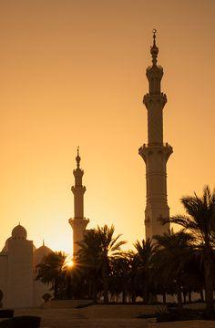 Sunset over Mosques minarets - Abu Dhabi. Sheikh Zayed Grand Mosque  UAE