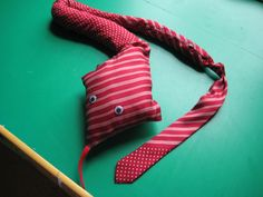 A tie made from a man's neck tie.  Filled with beans & stuffing, added eyes & a tongue.