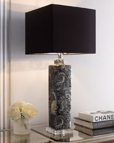 Paisley table lamp with black shade.