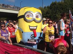 Chris Cooper, 43, running the Great North Run dressed up as a Minion from popular children's animation 'Despicable Me for Cash for Kids