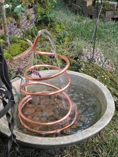 7 Soothing DIY Garden Fountain Ideas Definitely want a water feature, maybe or even A DIY water feature project for the winter months so I'll be ready next spring!