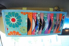 make your own car visor CD holder, this way it matches your decor or style