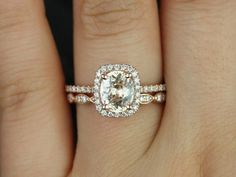 This gorgeous one of a kind wedding set cant be replicated. No two peachy pink sapphires are EVER the same. The Romani engagement ring is paired with