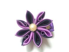 A personal favorite from my Etsy shop https://www.etsy.com/listing/483965371/purple-kanzashi-clip
