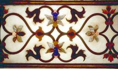 The symmetry and precision of a Mughal design executed in gem stone embedded pietra dura.