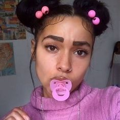 stop...just stop..... there are so many things wrong with this selfie.  1 the hair 2 the binkie *really?* 3 Can someone PLEASE show this girl how to do eyebrows.