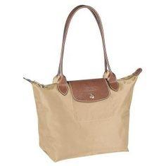 Beige Le Pliage Medium sized Longchamp tote bag. Weekend away?
