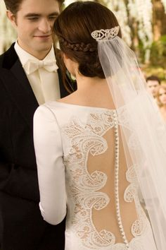 (I know this was in Breaking Dawn) BUT Carolina Herrera ... Wow.  the back w/ the lace and buttons... PERFECT!