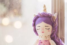 Nebu Handmade cloth doll. Limited edition of unicorn dolls by Mandarinas de Tela. I embroidered every detail by hand. Her dresses are made with cotton fabrics and small vintage buttons. In each of these unicorn girls there is something magical, innocence and lots of love! ♥  The dolls are 15.5inch / 40cm tall. They can move their arms and legs, the dress can be drawn.  Materials: Cotton fabrics, felt, lace, wool, embroidery threads, buttons, thread, stuffing.  Please read the store policies…