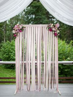 Ribbons and flowers - a beautiful ceremony backdrop idea.