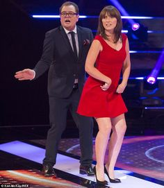 Time for a dance? Davina McCall flashed her pins in her striking dress, while joking around with Alan Carr