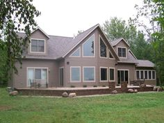 custom chalet style modular home with gorgeous windows and patio to enjoy the views - Chalet Style Modular Home Plans
