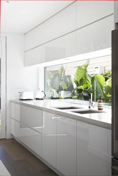 Slick white kitchen of stylist Aimee Tarulli of Archer Interiors