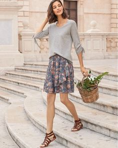 Fun and flirty, our short pull-on skirt gets a flattering degree of fullness from an asymmetrical ruffled front and hem. In soft and slightly crinkled silk chiffon.