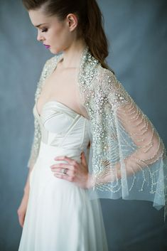 The Ursa Major wrap: A Carol Hannah favorite, this extravagantly gorgeous wrap adds layers of texture and glitz to any gown! Wear it down the aisle for coverage or throw it on as your final look leaving your reception! Crystal, beading, and sequins on tulle. Photography: Matthew Ree