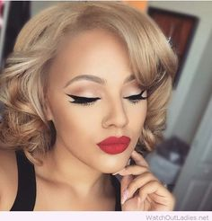 Short blonde curly hair with cat eye and red lips