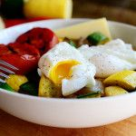 Carb Buster Breakfast Bowl : poached eggs over cooked (or grilled) veggies, with a turkey sausage link, and slice of cheese.