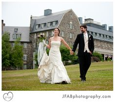 Skytop Bride & Groom Maggie and Austin stroll the great lawn in front of the stately Skytop Lodge.
