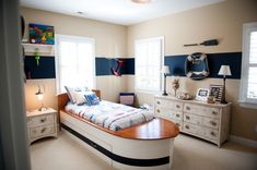 "Davis Nautical Room, My 3 year old loves boats and the beach, so we made his room in that theme., Shot of the ""boat bed"", distressed dresser, and paddle., Boys Rooms Design"