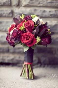 Burgundy and red, ivory accent bouquet black baccaras, safari sunset