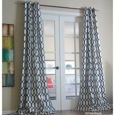 Give any room a stylish update with these polyester grommet curtain panels. The bold circle pattern complements the solid-color background for a contemporary look. A variety of color options allows you to find one that complements any decor.