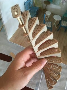 Partially constructed miniature spiral staircase, made by Amy Fletcher from mini amy blog.