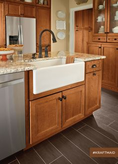 This farmhouse kitchen sink base represents just one of the specialized kitchen sink bases KraftMaid offers. (cherry cabinets in Praline)