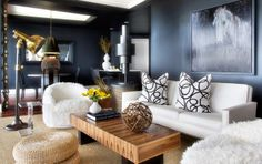 Dark walled room that still looks inviting, comfortable and decorated elegantly