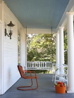 Reminds me of our front porch. Like the wall light instead of ceiling pendant. Pretty much the same color floor (although ours is concrete - I do like the wood better however!!)