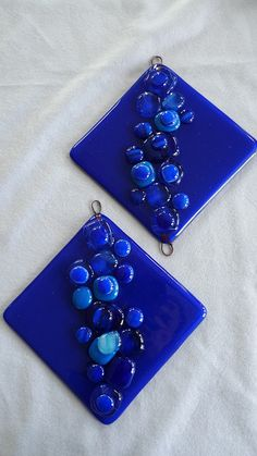 Blue wall hangings by Buddha Kitty Glass, via Flickr